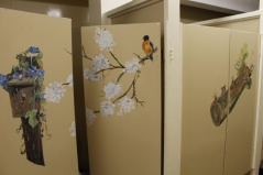 Paintings on the women's bathroom doors at a campsite near Milton Ontario