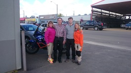 With Penny and Shawn in front of the Chrysler dealership
