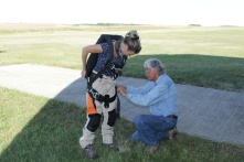 Putting on the parachute before the flight
