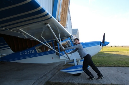 Pushing the plane back into the hanger