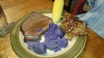 Dinner-> Bison roast, purple belgium potatoes, corn on the cob and zucchini potato puffer