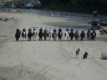 Some police on horses in Vancouver on the beach doing stuff