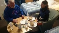 Ray explaining to Franziska how to break up a crab