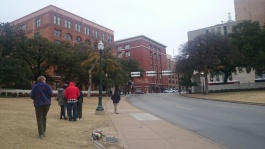 Dealey Plaza Dallas, the alleged shooter location was in the building on the left hand side on the top floor right hand corner window
