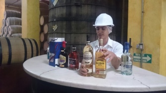 Our tour guide showing us the different kinds of Tequila