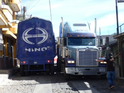 Trucks trying to squeeze through town