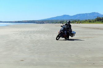 Riding the bike on the beach in El Salvador