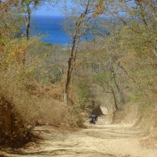 Dirt road, San Juan del Sur, steeper then it looks in the photo, so Franziska got off just in case