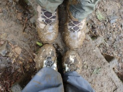Muddy shoes after hiking at Tenorio Volcano National Park