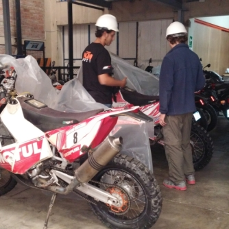 Sidyk showing me the Dakar competition bikes